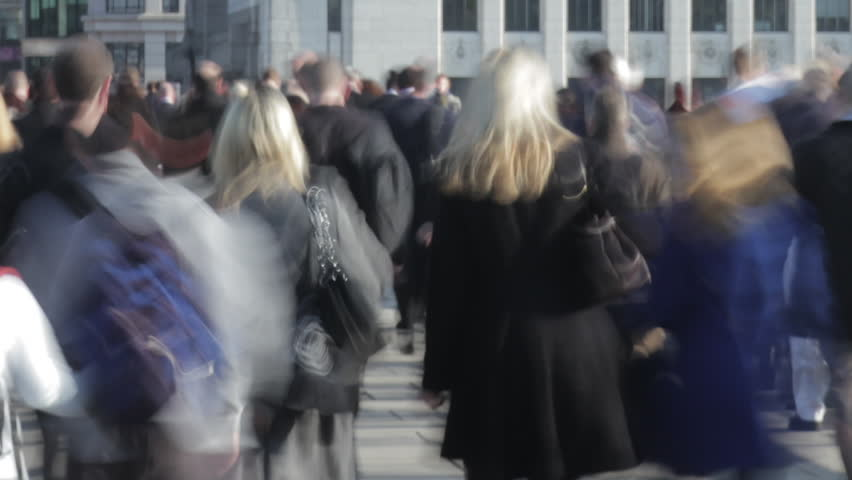 Time-lapse of rush hour commuters and traffic on London Bridge close up