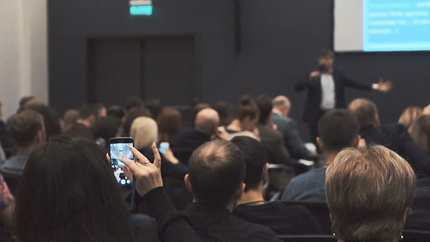People at a conference or presentation, workshop, master class photograph, picture gadgets make smartphones and tablets. Back view. | Shutterstock HD Video #23380090