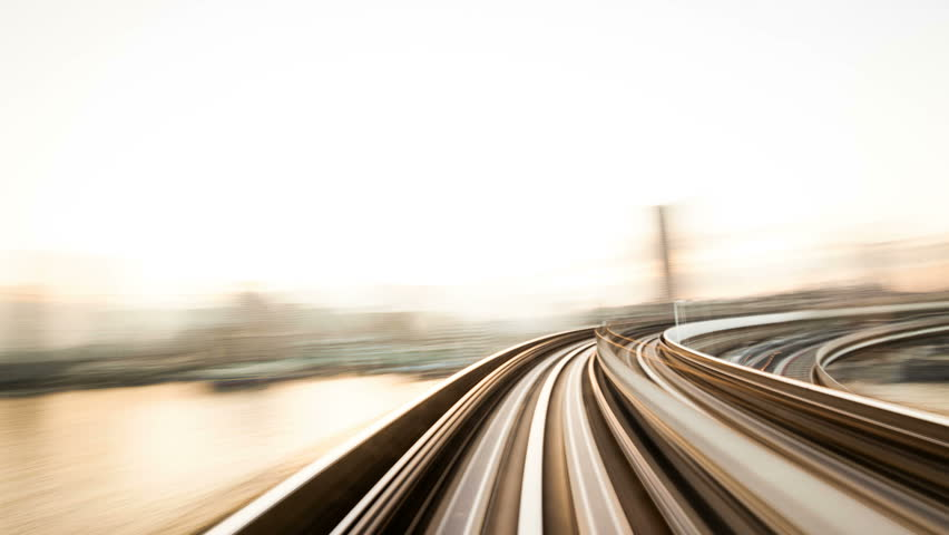 Timelapse view of the New Transit Yurikamome driverless train at Daiba on February 23, 2012 in Tokyo, Japan