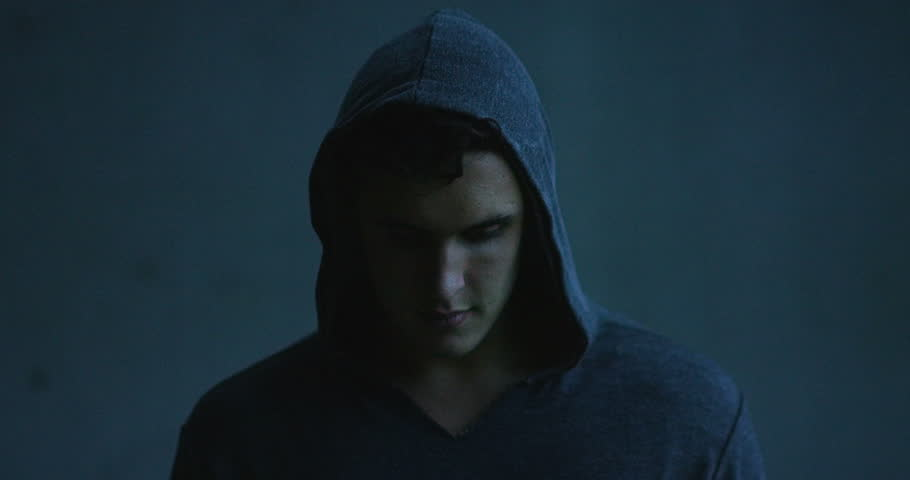 A guy full of energy, anger and strength, with the sweatshirt and hood, is a gritty wail of ambition, strength, anger and passion together. Concept: gym, effort, love, portrait.