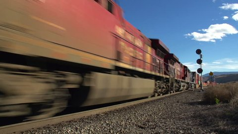 railroad, fast approaching container train, wide shot. ca.2016 rural British Columbia