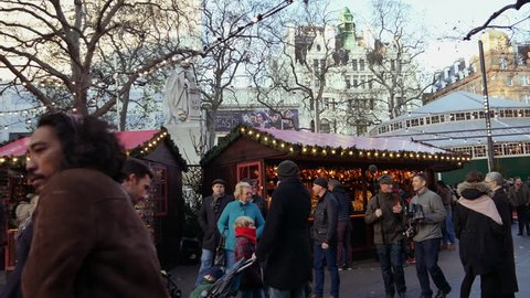 LONDON, ENGLAND - December 21: Chrismas Market and Shopping Street in Leicester Square Theatreland in London People Walk Visit ( Ultra High Definition, Ultra HD, UHD, 4K, real time )