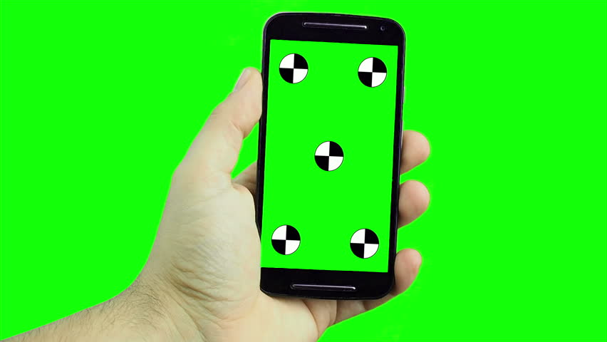 Male Hand holding smartphone with tracking markers against green screen