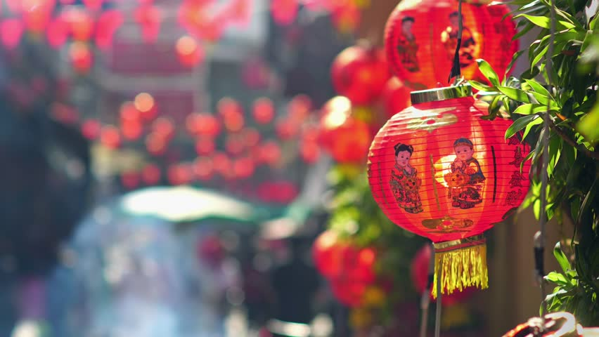 Chinese new year lanterns in china town.  Ancestor Worship on Chinese New Year and burning paper gold