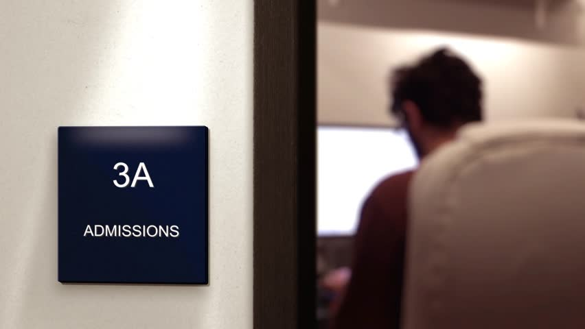 Interior Corporate Office Sign from Hallway   Admissions