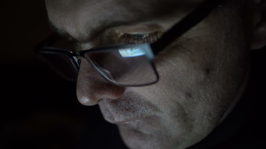 Closeup shot of middle age man in glasses surfing internet at night | Shutterstock HD Video #23559907
