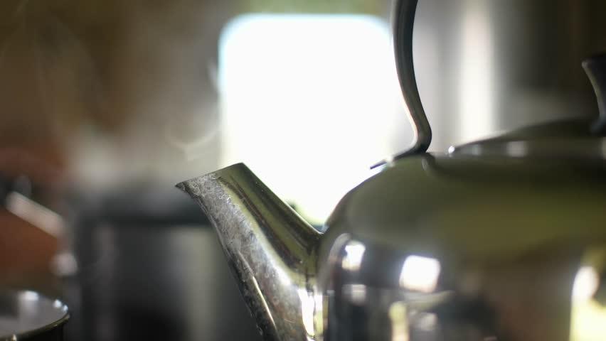 Kettle boiling on hob