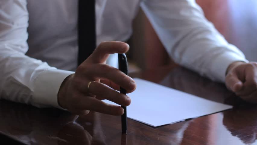 Business man, a man writes with a ballpoint pen | Shutterstock HD Video #23582077