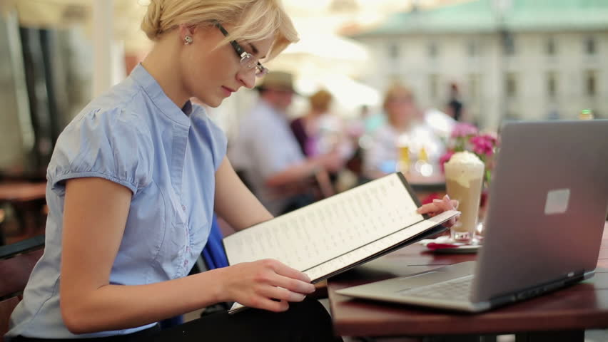 Young businesswoman reading menu in restaurant - HD stock video clip