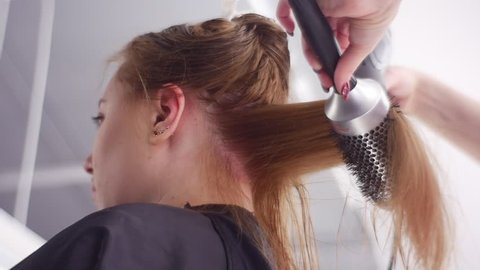 Hair-Saving Tips, Hairs Blow-Drying, the Best Technique. Slow Motion. Taken Down Up. Hair Care. the Hairs Are Separated Into Sections and Fixed Up. Salon Hair Treatment by Well Qualified Hairdresser.