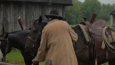 VIRGINIA - 2014. Re-enactment recreation of classic Old West, 1800s Western. shooting & riding on horseback. Cowboys and Outlaws. 1870-1890 western life. Guns and shootouts. OK Corral. Tombstone.