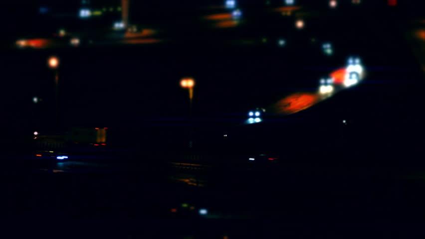 Cars Traffic. Cars driving on a road junction in the night city. Tilt shift. (av31563c)