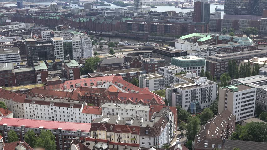 4K Aerial view of old building in Hamburg, red brick architecture and canal water emblem