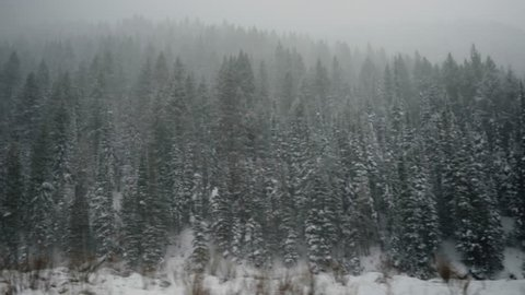 POV Shot From Moving Vehicle, In Winter Storm In Utah Mountains