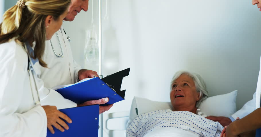 Group of doctors relieving old woman in hospital | Shutterstock HD Video #23822686