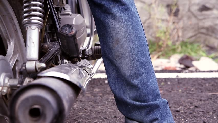 A Man start the motorcycle.  | Shutterstock HD Video #23832097
