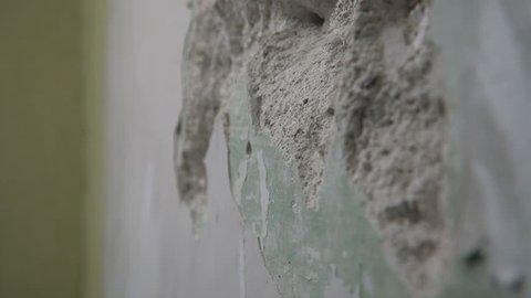 Smashing through concrete wall in slow motion