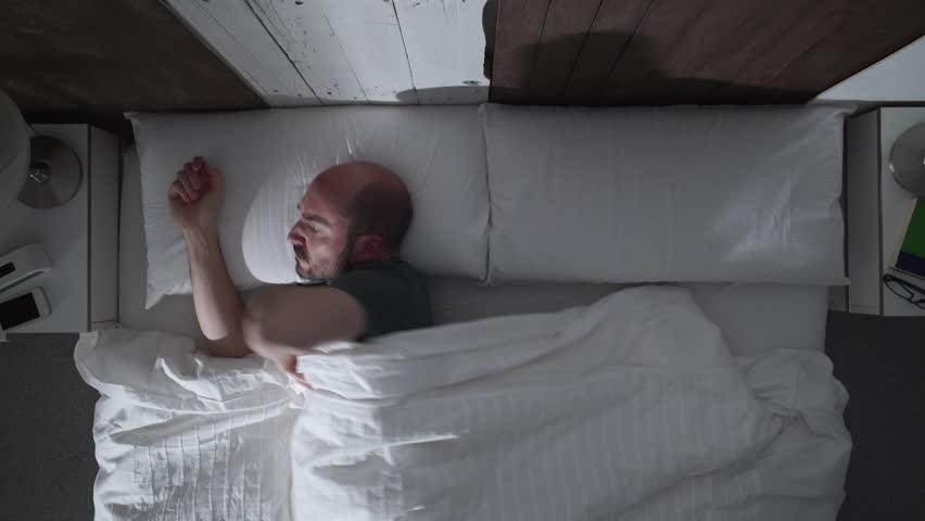Frustrated And Angry Person Under Covers In Bed Being Kept