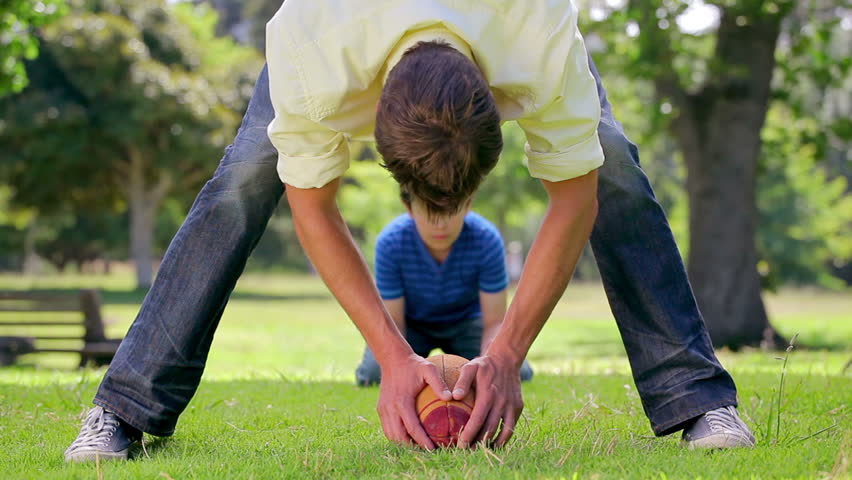 Smiling father passing the baseball to his son in the countryside | Shutterstock HD Video #2386502