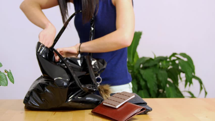 young woman searching for her mobile phone in her bag