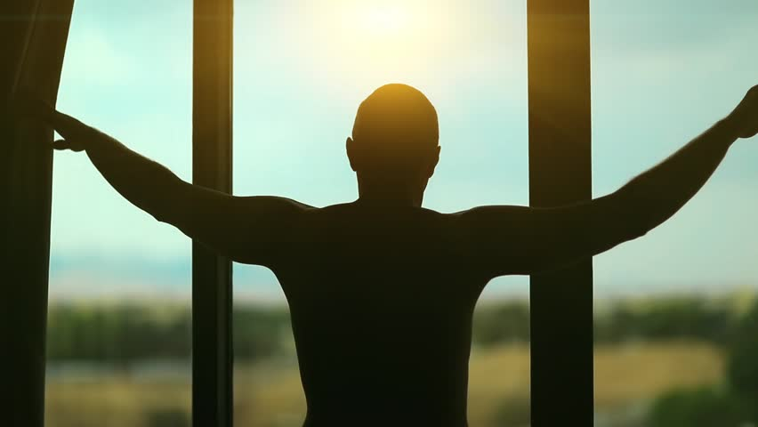 Man opens the curtains in the morning and reaches for the light. Young man opens big window curtains and lets the sun light in the room | Shutterstock HD Video #23894677