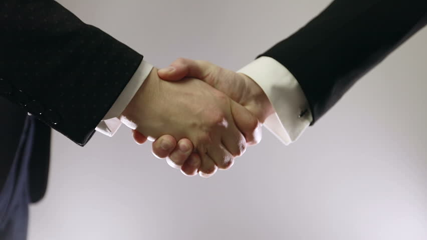 Slow motion. Handshake of two business people.