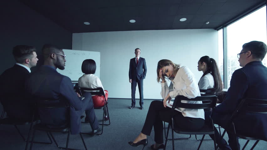 Woman expressing boredom and anger during the presentation. | Shutterstock HD Video #23929777