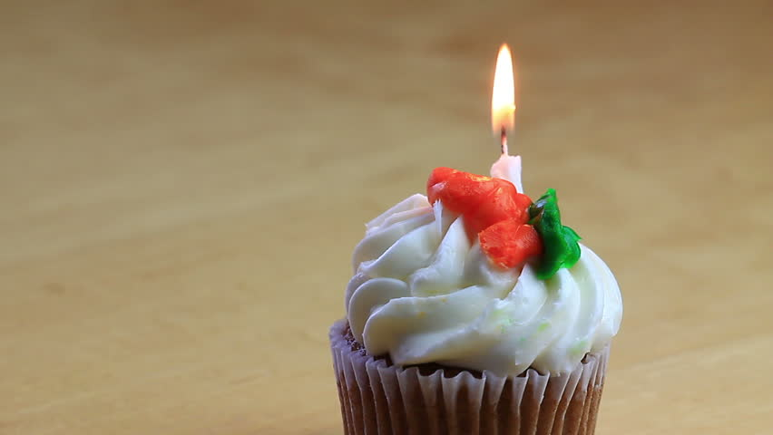 One Carrot Cake Birthday Cupcake With Four Burning White