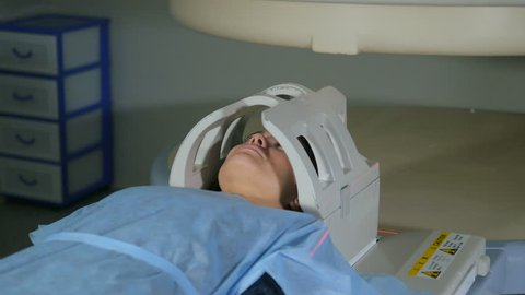 Young girl doing an MRI. Magnetic resonance imaging.
