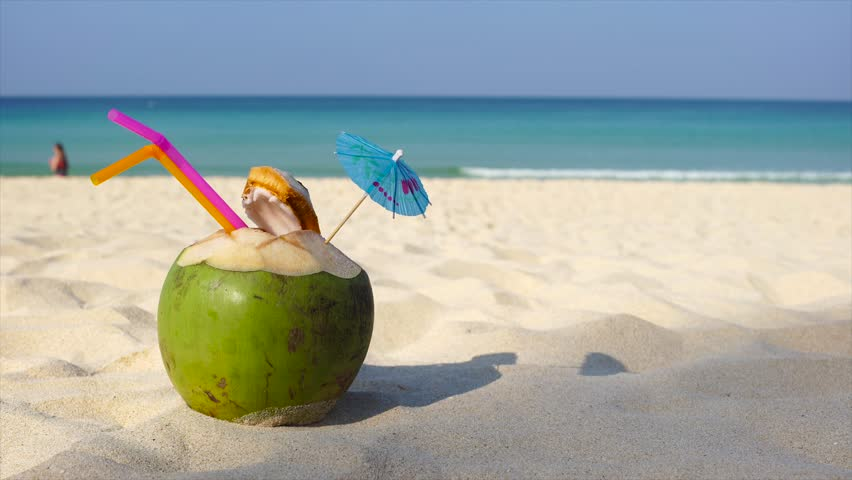 Fresh Coconut Sunglasses And Flip Flops On Sandy White Beach Man Vacation
