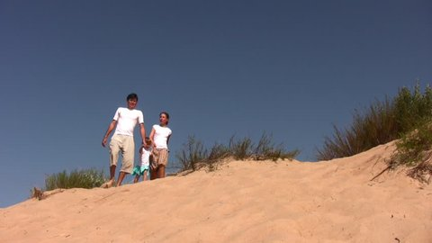 family of four on sea-bank