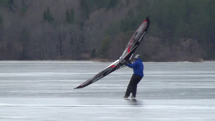 A man skating sailing on the lake and crash.