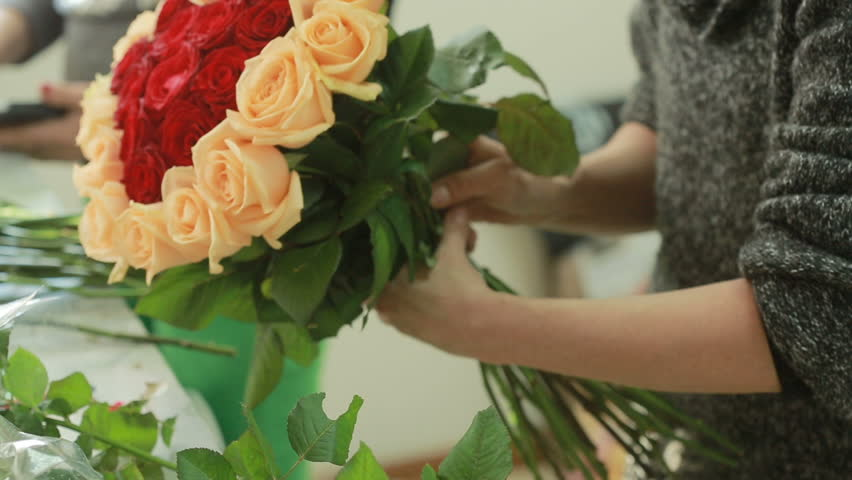 Bright colorful bouquet of red and peach roses, florist woman gathers a bouquet. time lapse | Shutterstock HD Video #24129949