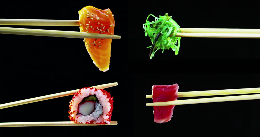 composition of sushi,sashimi,uramaki and nighiri.typical Japanese dish consisting of rice, salmon, tuna,shrimp and fish eggs on a black background.Concept:Japanese restaurant,sushi,oriental tradition