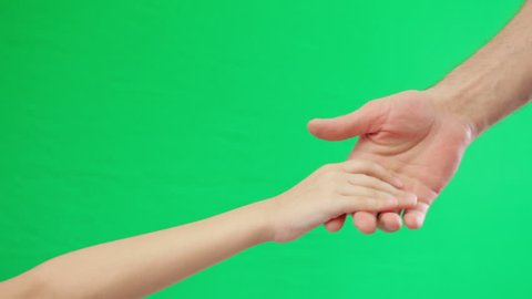 Two holding hands on green screen background. Adult male and teen female hands handshake. Green screen background.