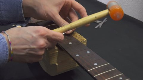 Guitar Maker Fixing Guitar Fretboard