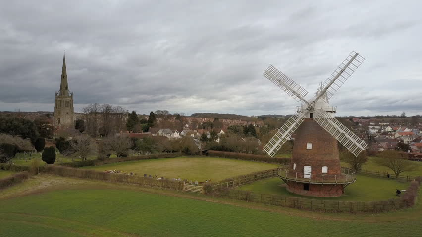 Thaxted village, Essex, England. Drone video footage flying low towards the Essex village of Thaxted past its landmark windmill and parish church.
