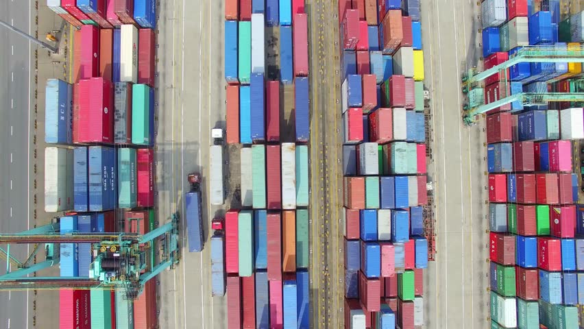 container ship in import export and business logistic.By crane , Trade Port , Shipping.Tugboat assisting cargo to harbor.Aerial view. #24217627