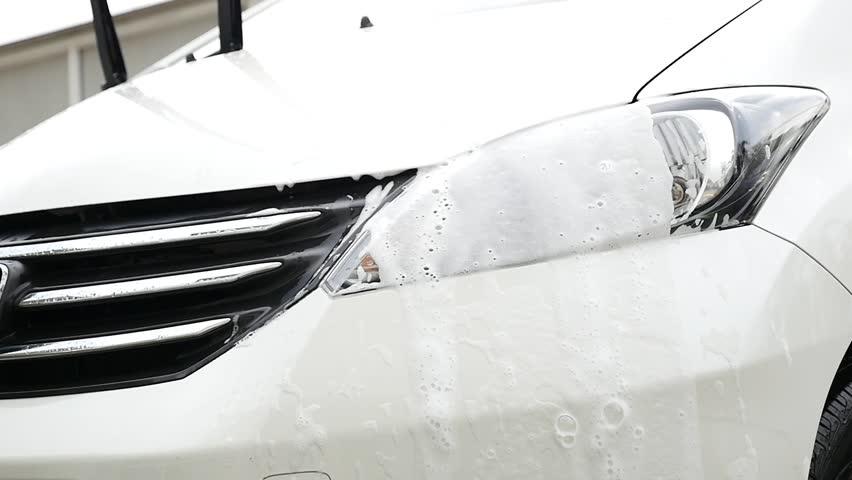 Asian girl washing a car   Shutterstock HD Video #24275387