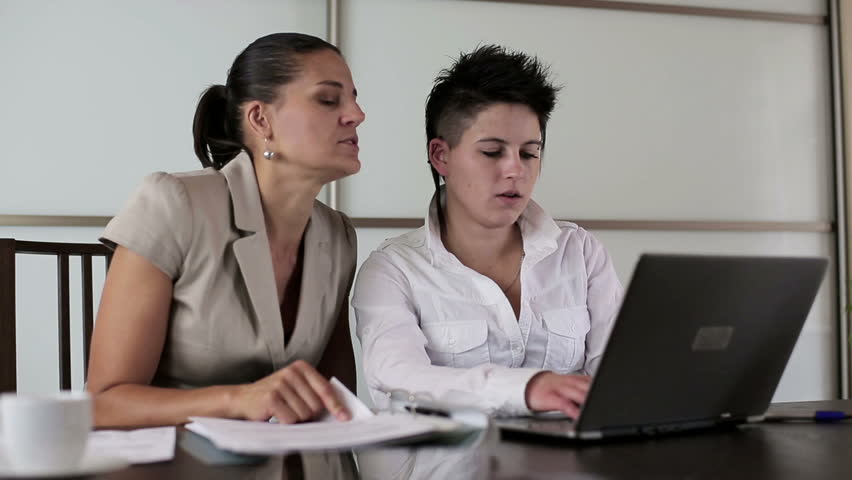 Businesswomen with laptop and documents in the office, steadicam shot  | Shutterstock HD Video #2428907