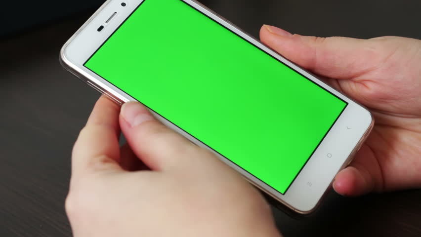 Touch Screen On White Smartphone Green Screen.Using Smartphone,Holding Smartphone with Green Screen | Shutterstock HD Video #24309287