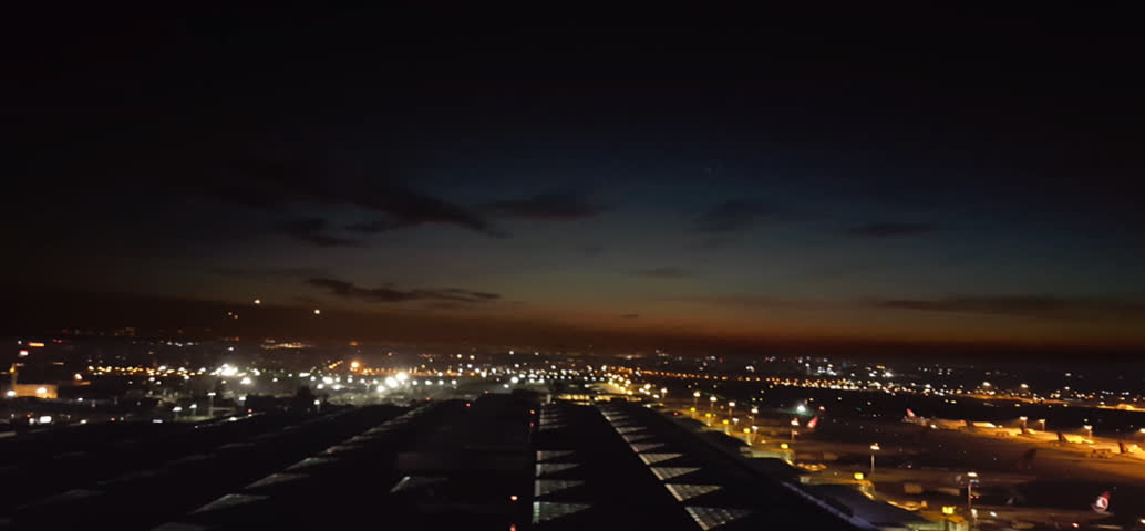 Istanbul, Turkey; February 23 2017: Airplane landings during the sunrise hyperlapse movie from Ataturk Airport.