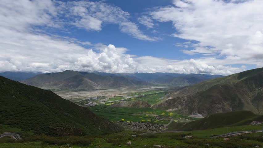 Stunning timelapse of Tibetan valley landscape of mountains and beautiful clouds