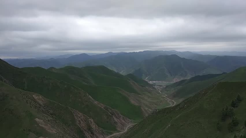 Timelapse of beautiful mountain landscape and clouds in Xiahe, China