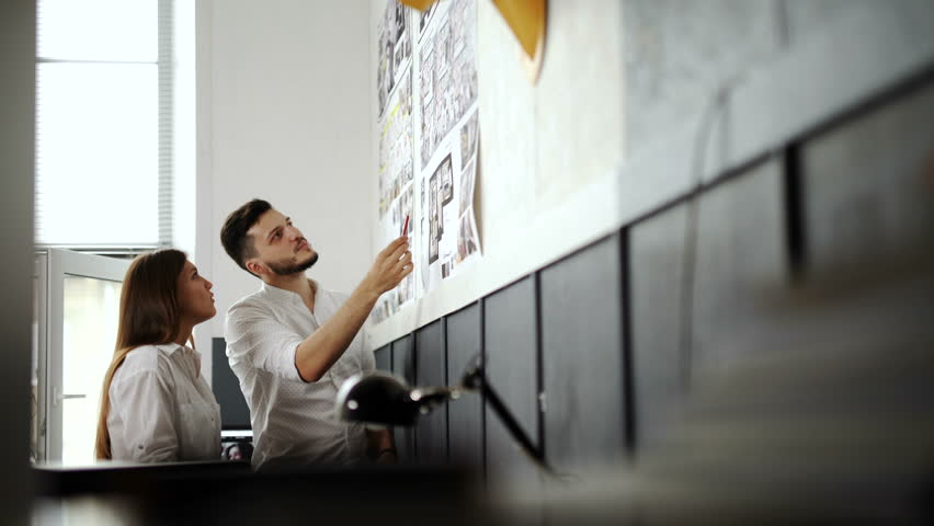 Business, startup, education and people concept - creative architect team or students with blueprint working at office 20s 4k. | Shutterstock HD Video #24347297