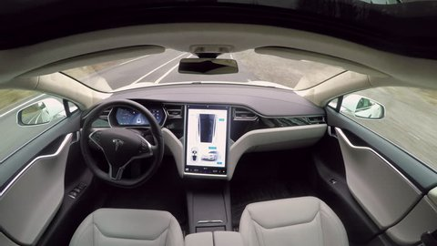 LINZ, AUSTRIA - FEBRUARY 2nd 2017: Absolutely autonomous self-driving Tesla Model S autopilot and trully driverless car with empty seat and no driver. Next gen ultrasonic sensors, cameras and radars