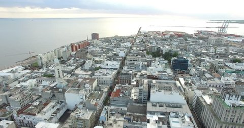Sweeping aerial drone shot of Montevideo port