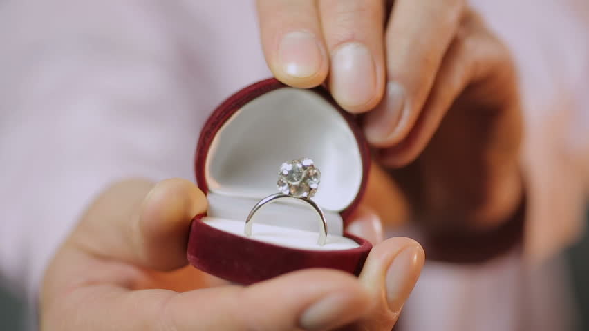 Shine Of Engagement Ring Mens Hands Open Boxes In Which There Is