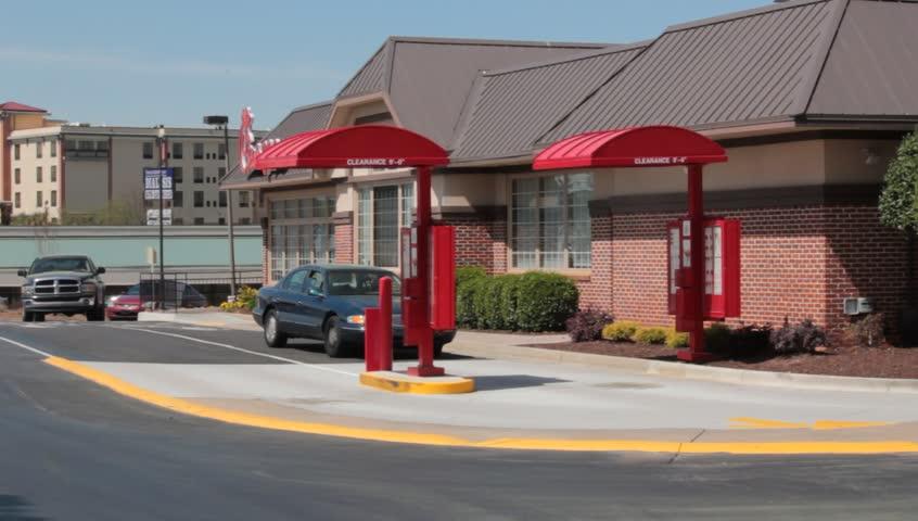 Stockbridge, GA. Circa 2015: A Car Drives up to the Drive Thru at a Chick-Fil-A Fast Ffood Restaurant