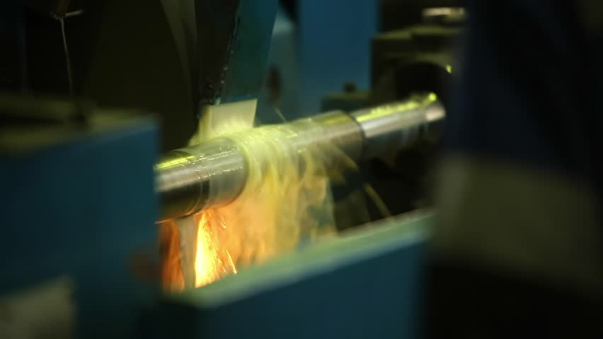 Omsk 02.10.2013  Sharpening machine grinds iron with coolant with flashes of light and sparks